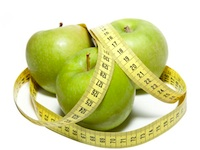 Apples with tape measure